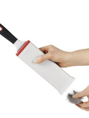 Cepillo quitapelusas autolimpiable OXO para tapicerías